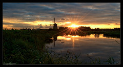 Twiske Flare (Joost N.) Tags: travel sunset sky holland mill tourism nature water dutch zonsondergang nederland natuur sunny flare riet fietsen molen twiske