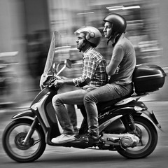 Going Nowhere Fast (Unhappy Couple On Scooter), Bologna (flatworldsedge) Tags: travel italy white motion black blur speed liberty couple italia wheels bored guys scooter jeans riding crop bologna argument tight panning unhappy helmets foldedarms silenttreatment bwartaward yahoo:yourpictures=blackandwhite