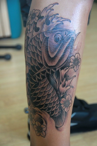 TwoThumbs Tattoo Oahu Hawaii. Asian Arowana Tattoo.