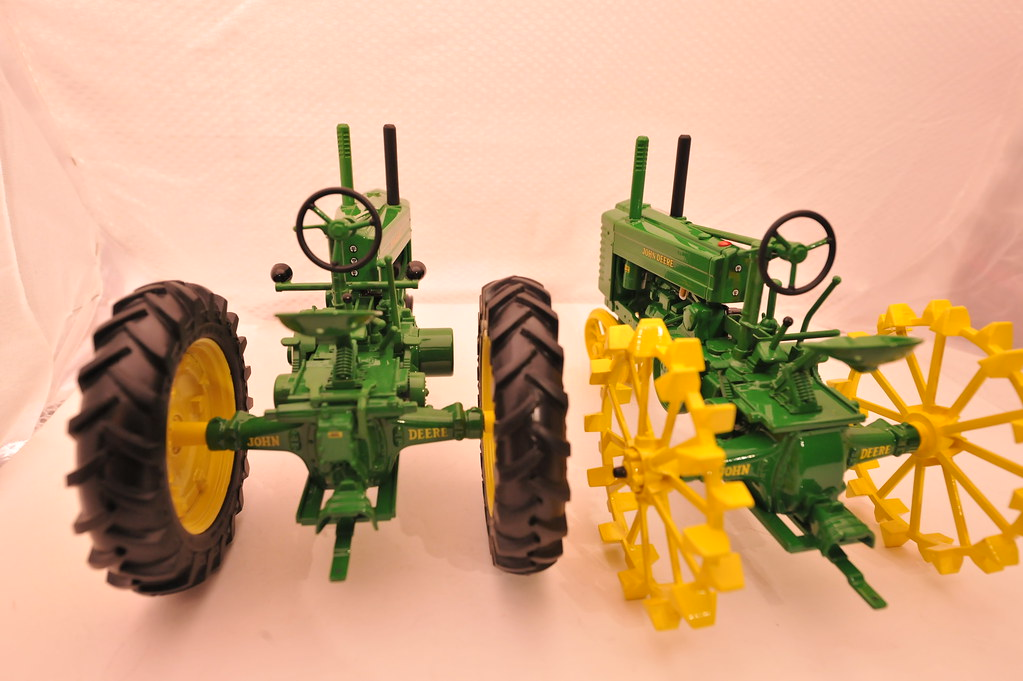 1942  John  Deere  GM two versions 2010 Two Cylinder Club toy left, award right  1/16th  diecast  metal  by  Ertl