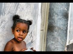 Sweet Girl (Polis Poliviou) Tags: girl beauty face wall kid child cuba communism revolution trinidad caribbean che cuban plazamayor tobacco cubalibre visualart cheguevara polis caribbeanbeach muchacha portrit eys republicofcuba spanishcolonialarchitecture republicadecuba sanctispritus lovelycuba shiningstar afiap flickrestrellas superaward diegovelzquezdecullar flickraward unescosworldheritagesites poliviou polispoliviou  fotowow portraitsofallcountries artistefiap   valleydelosingenios cubantown