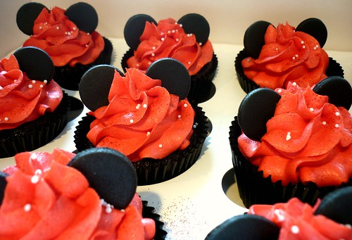 Mouse ear cupcakes on red swirls