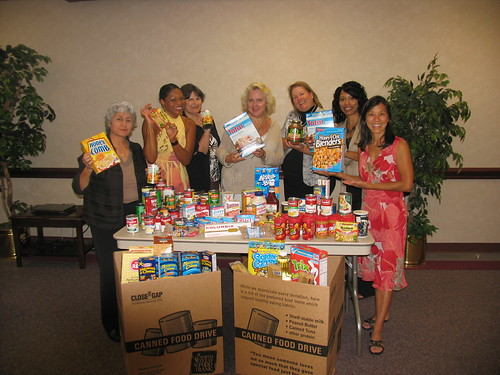 Lupe Gomez, Coordinator and WIC staff show their contributions to the food drive.