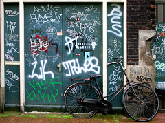 Bicycle (Andrea Kennard) Tags: old city travel family house holland building brick history tourism home water netherlands dutch amsterdam bicycle stone wall architecture river graffiti canal ancient europe european pattern cityscape view unique live traditional capital style icon tourist structure retro mansion sight typical narrow dwelling