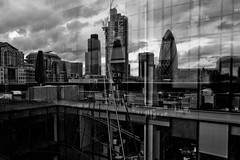 One Bishops Square (Gary Kinsman) Tags: bw reflection london skyline architecture clouds dark blackwhite overcast canon5d gherkin openhouse e1 spitalfields 30stmaryaxe tower42 cityoflondon 2010 londonist canon1740mmf4l herontower onebishopssquare