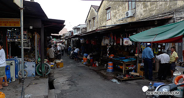 A street lined with stores peddling various hardwares