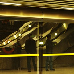 canary wharf (Cosimo Matteini) Tags: people distortion reflection london station yellow pen underground person 50mm candid escalator tube olympus docklands f18 canarywharf zuiko fragmented m43 mft epl1 cosimomatteini