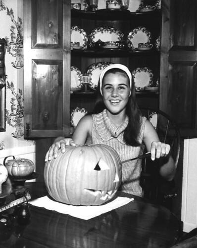 Pine Crest School student carving a Halloween pumpkin: Fort Lauderdale, Florida