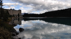 The Fairmont Chateau Lake Louise reflected in Lake Louise (Photography Through Tania's Eyes) Tags: autumn red canada mountains reflection nature water landscape boats hotel photo flora nikon rocks photographer picture canoe snowcapped photograph alberta vegetation lakelouise banffnationalpark chateaulakelouise copyrightimages taniasimpson