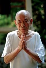 Monk Chihiro (thomasmperry) Tags: white japanese one shiny peace head prayer bald peaceful tshirt monk eyebrow plain raised
