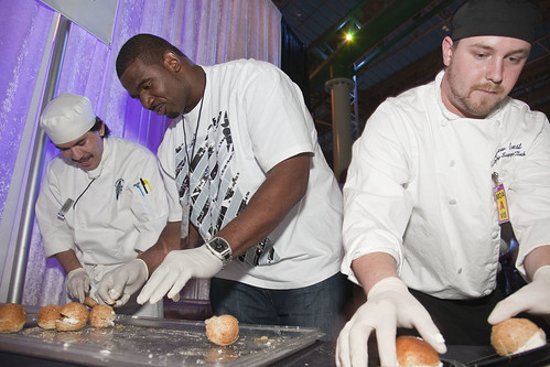 Vikings Defensive Tackle Jimmy Kennedy tackles the task at hand: serving sandwiches to fans at the team's annual Taste of the NFL event.
