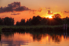 Sunset @ Poldervaart Revised (DolliaSH) Tags: light sunset sky orange sun holland color reflection sol water colors clouds canon reflections atardecer photography lights soleil photo zonsondergang topf50 europe tramonto foto sonnenuntergang photos nederland thenetherlands paisaje sole sonne topf100 coucherdesoleil puestadelsol zuidholland 1755 zakat southholland 50d canoneos50d solntse dollia dollias sheombar dolliash