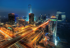 Bustling Beijing (Stuck in Customs) Tags: china city travel light skyline architecture night digital skyscraper buildings photography evening blog high asia punk neon glow cityscape republic nightshot traffic dynamic stuck district beijing east business photoblog software processing metropolis imaging cbd  prc northern range financial development hdr tutorial trey cyber peking cyberpunk travelblog customs municipality bijng ratcliff northernchina beijingcbd hdrtutorial stuckincustoms treyratcliff photographyblog peoplesrepublicofchina stuckincustomscom beijingcentralbusinessdistrict   bijngshngwzhngxnq