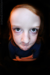 one is not amused (possessed2fisheye) Tags: portrait kid eyes fisheye littleboy grumpy floatinghead meanie ringlight headandshoulders nomorepictures arewedoneyet giantfloatinghead diyringlight fullframefisheye irefusetosmile littlecutiepie fisheyeportrait portraitonblack iamnotamused optika65mmfullframefisheye fisheyemenace facelitbuyringlight
