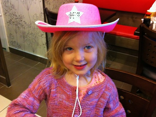 Hannah rocks her new cowgirl hat