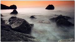 somewhere behind (chris frick) Tags: longexposure autumn sunset sea seascape fall rocks exposure silhouettes frame 169 mallorca tobacco pp cokin a550 chrisfrick bensdavall somewherebehind sonyalpha550 smokysea