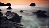 somewhere behind (chris frick) Tags: longexposure autumn sunset sea seascape fall rocks exposure silhouettes frame 169 mallorca tobacco pp cokin a550 chrisfrick bensdavall somewherebehind sonyalpha550 smokysea