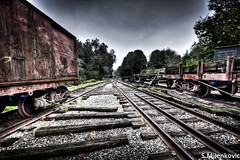 Left behind (Sasja Milenkovic) Tags: old building graveyard clouds train canon eos belgium belgie trainstation nostalgic locomotive 1022mm hdr trein 1022 lightroom kerkhof photomatix treinstel 3exp canon50d lokomotief eoscanon50d