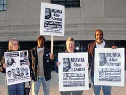 MECAWI members Cheryl LaBash, Derrick Grigsby, Martha Grevatt and Abayomi Azikiwe outside the federal courthouse in downtown Detroit on Nov. 9, 2010 in solidarity with Mumia Abu-Jamal. (Photo: Bryan Pfeifer) by Pan-African News Wire File Photos