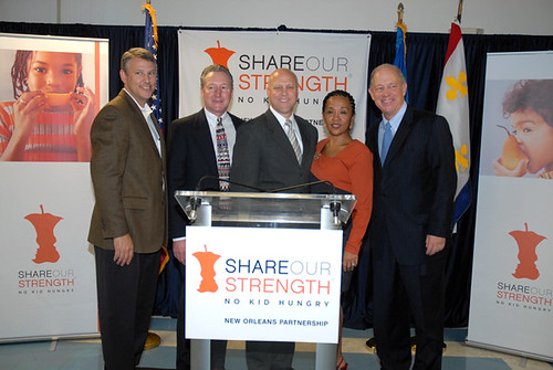A few of the partners in the No Kid Hungry initiative were represented at the kick-off. Left to right are:  Tracy Rosser, senior vice-president of Walmart, Mississippi River Delta Division; Bill Ludwig, regional administrator for Food and Nutrition Service Southwest Region; Mitch Landrieu, mayor of New Orleans; Carol Carter, director of Sojourner Truth Neighborhood Center; and Billy Shore, founder and executive director of Share Our Strength.