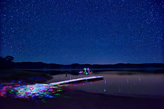 The Light Painter's Dance (Fort Photo) Tags: blue sky lake lightpainting reflection nature night stars landscape lights star nikon nebraska glow indigo ne led astrophotography flashlight astronomy 2010 lightpaint d700 Astrometrydotnet:status=failed Astrometrydotnet:id=alpha20101237084780
