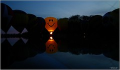 Smiley (-=[Joms]=-) Tags: reflection water colors night pond colorful balluminaria cincinnati edenpark wideangle smiley hotairballoon balloonfestival hs10 hs11 fujifilmfinepixhs10 fujihs10 fujifilmfinepixhs11 fujihs11