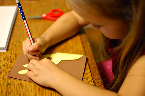 a child tracing reindeer shape onto a piece of paper