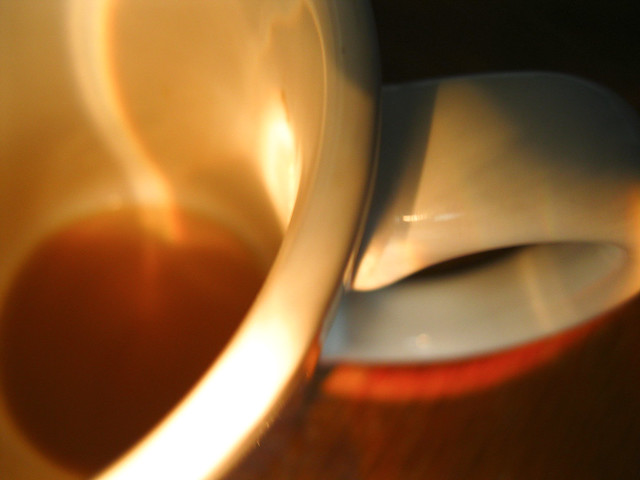 coffee mug illuminated by flashlight