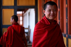 Lama of Punakha Dzong (Samir D) Tags: red people men face look canon eos 50mm asia dof bhutan bokeh buddhist monk dzong 18 2010 punakha 40d canon40d samird laqma