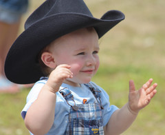 Baby Cowboy likes your pickin', son.