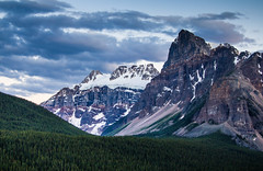 Towering Peaks (Jim Boud) Tags: travel blue sky mountain snow canada mountains tree green ice nature pinetree clouds forest canon lens landscape outdoors eos is nationalpark cloudy hiking hill rocky wideangle glacier alberta northamerica banff layers usm dslr 1785mm digitalrebel photoart digitalslr pinetrees efs1785mmf456isusm province firtree artisticphotography partlycloudy canadianrockies imagestabilization imagestabilized 550d jimboud t2i jamesboud eos550d kissx4