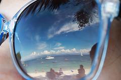 reflection (zazi56) Tags: blue sea sun reflection beach swimming swim glasses boat ship greece sunbathing mirroring paxoi