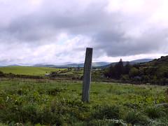 Kilnaruane Pillar Stone (Cathpetsch) Tags: ireland megalithic monument grass stone clouds landscape carved view hill viewpoint bantry countycork hilltop steen drumlin standingstone ierland placeofinterest meadowfield kilnaruane pillarstone panasonicdmctz6 megalithisch steenpilaar