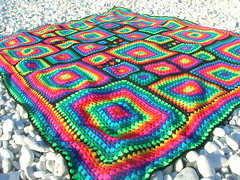 Irregular Rainbow Mosaic Crochet Afghan (babukatorium) Tags: pink blue red orange black color art lana wool yellow square rainbow funny warm purple handmade mosaic turquoise teal crochet violet blanket afghan hippie patchwork psychedelic arcobaleno manta multicolor bedspread whimsical haken hkeln emeraldgreen croch coperta grannysquares ganchillo fuxia uncinetto fattoamano copriletto  tii horgolt uvgreen babukatorium