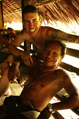 Cale and Lala (joeyL.com) Tags: lighting tattoo ferry trekking indonesia boat rainforest photoshoot battery uma culture photographers tourists generator western hunter guide explorers healing behindthescenes ricky travelers translator shamanism solarpower sacrafice gatherer joeylawrence profoto elinchrom joeyl mentawai siberut caleglendening gejeng willemisbrucker