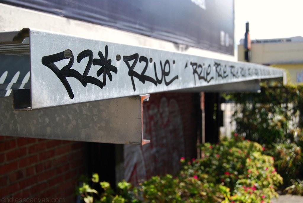 R2ue graffiti crushed the length of a billboard.