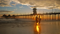 silhouetted sunset romance (jst images) Tags: california ca sunset reflection beach clouds pier couple romance orangecounty huntingtonbeach hb wetreflection hbpier huntingtonpier romanticcouple romanticsunset colorphotoaward justimages jasontockey jstimages jasontockeyphotography jasontockeyimages romanticseascape