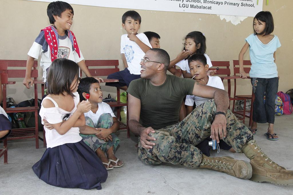 Sailor plays with Filipino children