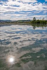 Little blue planet (Ignacio Lizarraga) Tags: autumn sky reflection water clouds agua paisaje cielo nubes reflejo land otoo scape tierra zyber nikond90 vanagram dsc01170622