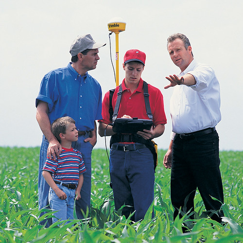 As well as helping them market and process their crops, co-ops also help farmers obtain farm supplies and provide them with important agronomy services, such as mapping their fields to ensure they use only the proper amounts of fertilizer, thus avoiding runoff problems.  Photo courtesy GROWMARK