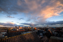 Rooftops at Sunset (Frenklin) Tags: sunset sky sun holland church netherlands colors skyline clouds zonsondergang cityscape rooftops dusk nederland thenetherlands wolken sigma groningen lucht 1020mm 1020 zon kerk hdr stad kleuren daken stadslandschap stadsgezicht naberpassage