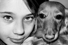 The girl and the dog (CWhatPhotos) Tags: canon eos 7d sigma 30mm fixed focal f14 monochrome black white eyes look portait lens digital slr camera cwhatphotos bronze ginger pictures picture photo photos image images foto fotos that have which contain taken brown dachshund dachound dog pet animal hound adobe lightroom paintshopprophoto animals cannon rest green grass doxie doxies dogs portrait portraits longhaired long haired weiner sausage wiener dackel teckle dachounds ex dc hsm exdchsm blackandwhite blackwhite photography monochromed flickr