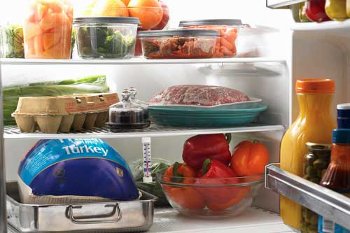 An example of a fresh turkey properly stored in the refrigerator immediately after returning from the store. The turkey is still in its original wrapper, has a tray to catch any juices that may leak, and was bought no more than two days before cooking.