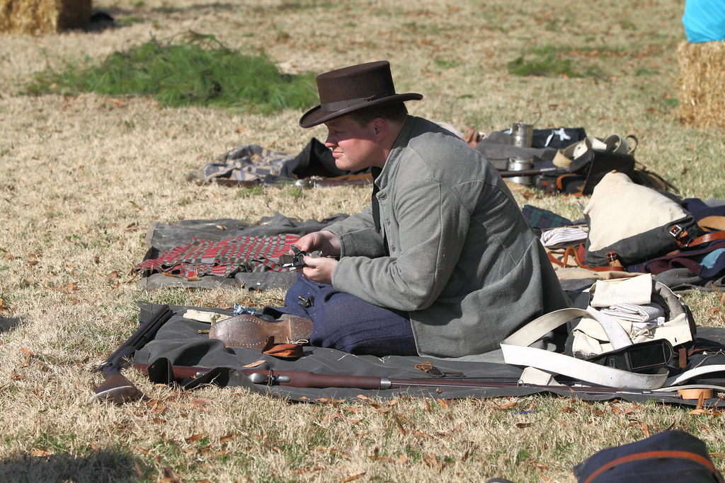 37th Confederate Infantry Reenactor Cleaning His Gun