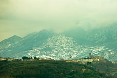 Fortress on the foothills (Raoul Pop) Tags: travel winter italy snow mountains castle clouds canon europe flickr italia seasons places hillside somewhere fortress ontheroad smugmug abruzzo canoneos5d googlephotos