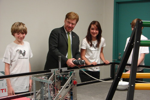 Attempting to operate the robot, to the amusement of robotics pros Georg Gillard and Rhiannon Waller of the Home School.