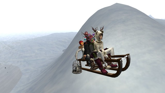 four crazy people on a sled - Torley Linden