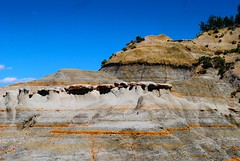 cool rock formations (ekelly80) Tags: june2017 northdakota theodorerooseveltnationalpark nps roadtrip keisgoesusa badlands rockformations scenery landscape layers colors mountains hills rocks orange view bumpy