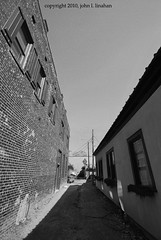 Photography Weekly Challenge (Classic Black and White) (Jobe Roco) Tags: urban blackandwhite bw building brick photoshop nikon louisiana downtown lafayette wideangle 1956 d60 sigma1020mm cmwdbw