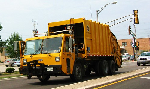 Eastbound yellow CCC garbage truck from the Skokie Public Works Refuse Collection Division. Skokie Illinois. July 2010. by Eddie from Chicago